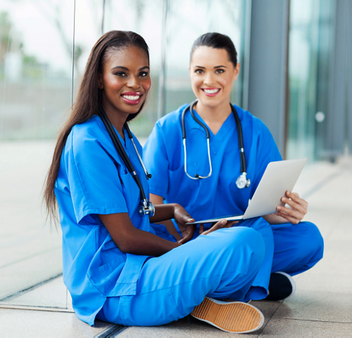 two beautiful nurses holding laptop