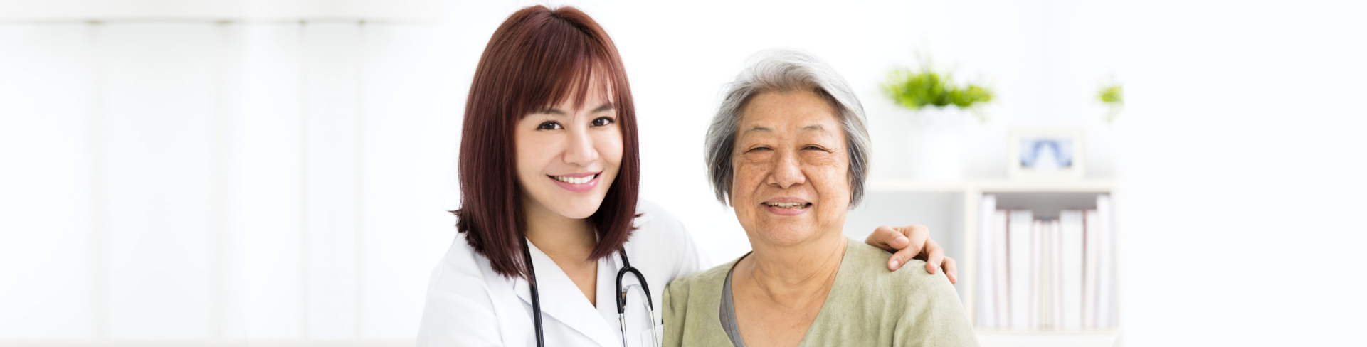 female doctor and senior woman smiling