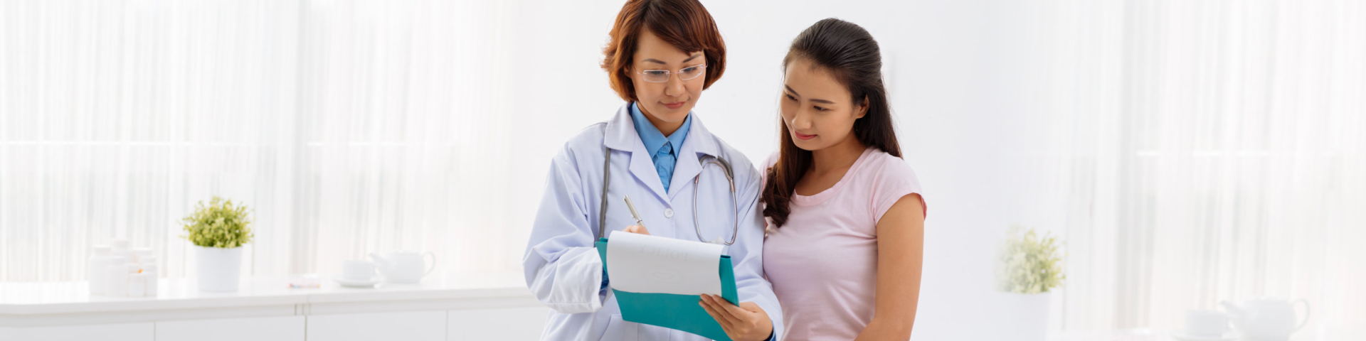 doctor and patient looking at a notepad