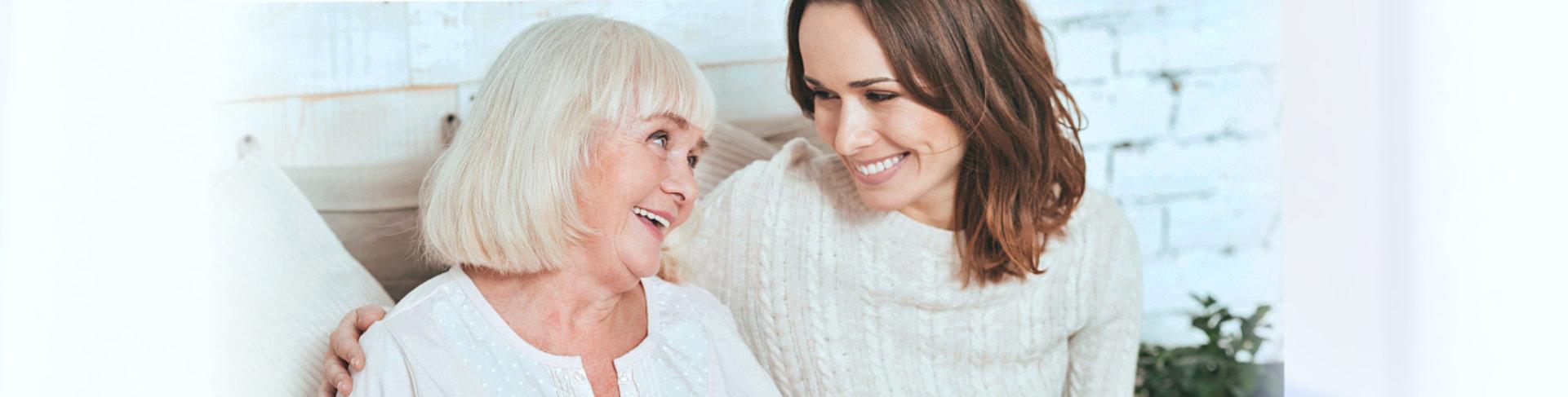 caregiver and elderly talking
